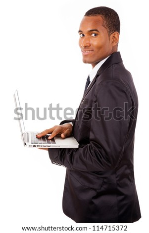 Smiling African business man with laptop, isolated on white
