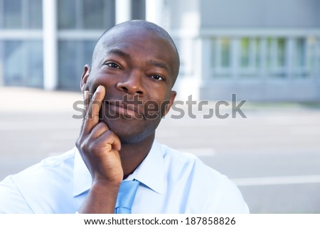 Smiling african businessman in front of his office  - stock photo