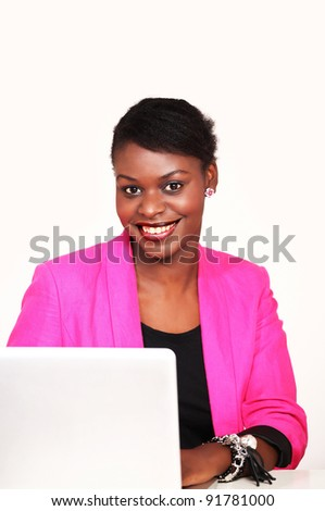 Smiling african businesswoman with laptop - stock photo
