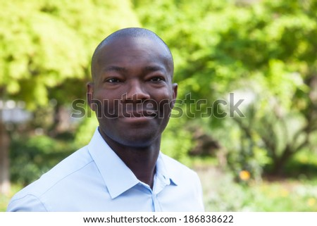 Smiling african man in a park