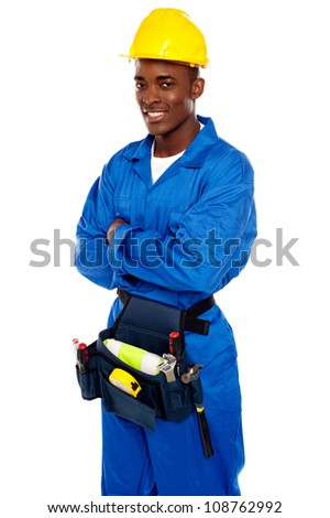 Smiling african worker posing with arms crossed isolated on white background