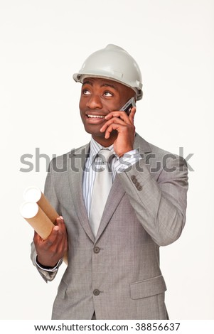 Smiling Afro-American architect speaking on mobile phone and holding plans against white background - stock photo