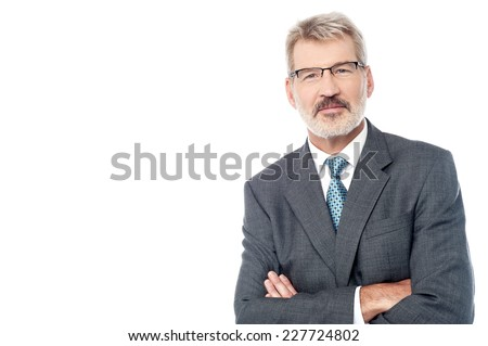 Smiling aged businessman posing with crossed arms  - stock photo
