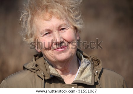 Smiling aged woman - stock photo