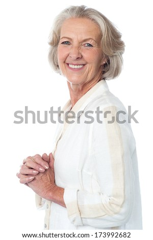 Smiling aged woman posing with clasped hands