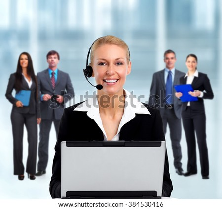 Smiling agent woman with headsets and laptop. - stock photo