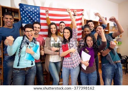 Smiling  American students presenting their country with flags - stock photo