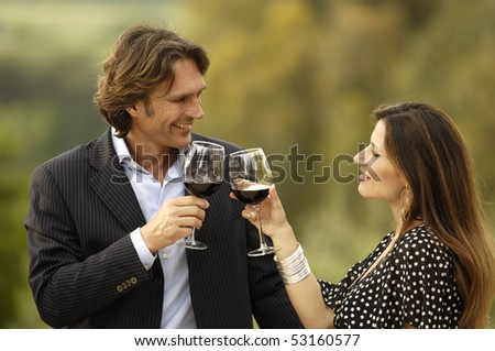 Smiling and celebrating with wine - stock photo