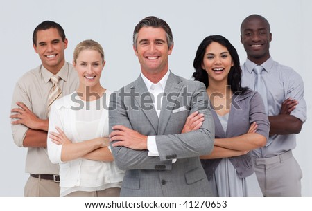 Smiling and confident business team standing against white background - stock photo