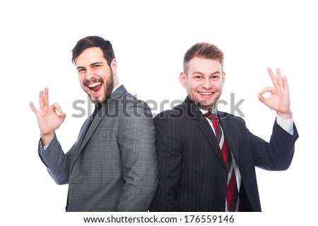 smiling and excited businessmen showing ok sign, successful sales men on white - stock photo