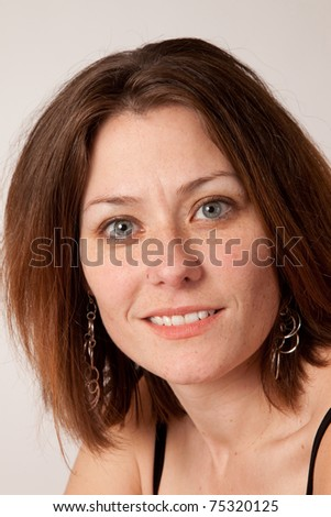 smiling and happy woman with eye contact