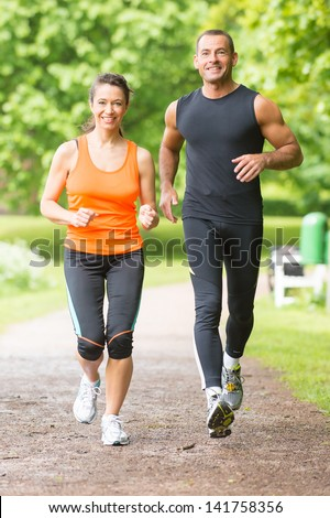 Smiling and running sport team - stock photo