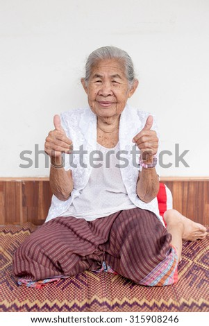 Smiling and thumb up elderly people ,asian of smile ,thailand - stock photo