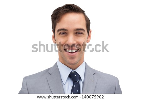 Smiling and young businessman against white background