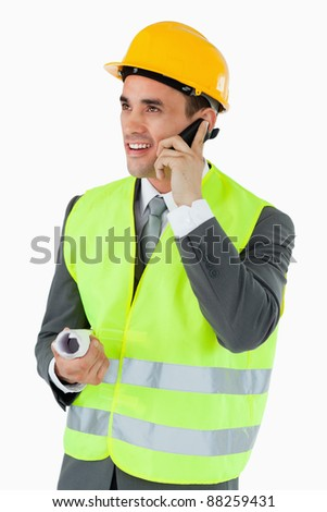 Smiling architect on the cellphone against a white background