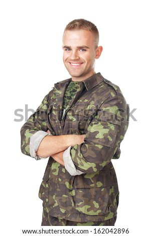 Smiling army soldier with his arms crossed isolated on white background - stock photo