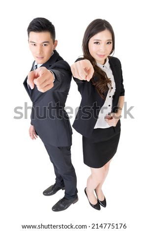 Smiling Asian business man and woman point at you, full length portrait on white background. - stock photo