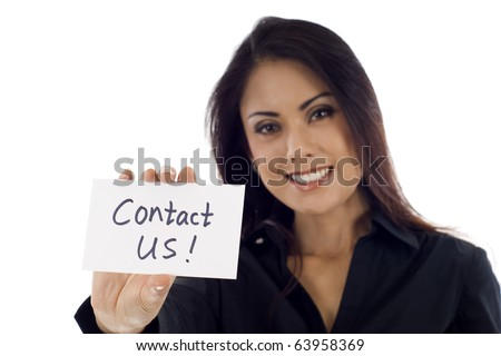 Smiling Asian business woman holding a card- Contact Us! isolated over white background