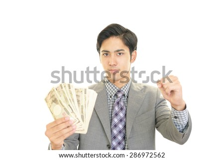 Smiling Asian businessman - stock photo
