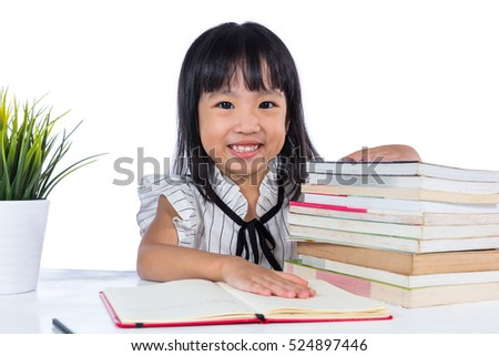 Smiling Asian Chinese little office lady sitting on the table reading book in isolated white background.