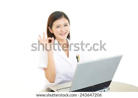 Smiling Asian female doctor - stock photo