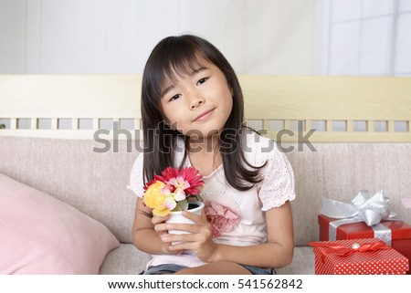 Smiling Asian girl with a gift