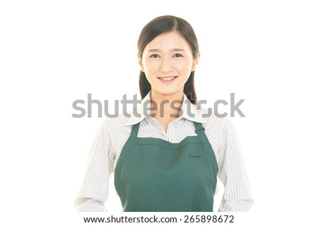 Smiling Asian housewife - stock photo