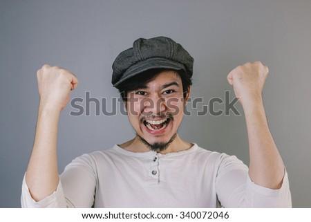 Smiling Asian man with flat cap. No shaving November. - stock photo