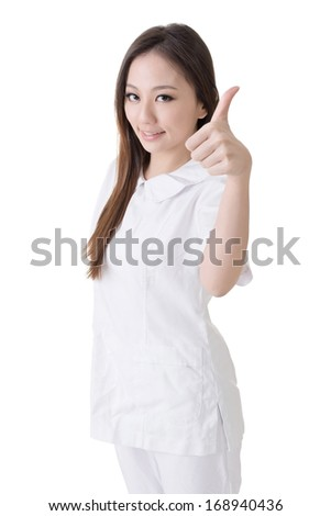 Smiling Asian nurse give an excellent sign, closeup woman portrait isolated on white background.