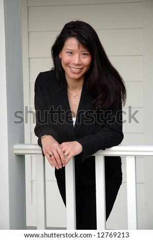 Smiling asian women in business suit - stock photo