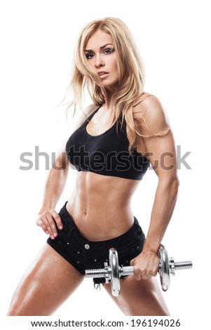 Smiling athletic woman pumping up muscles with dumbbells on white background - stock photo