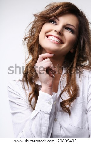 Smiling attractive brunette in white shirt. - stock photo