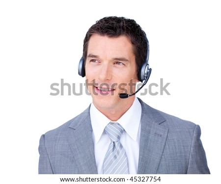 Smiling attractive businessman using headset against a white background - stock photo