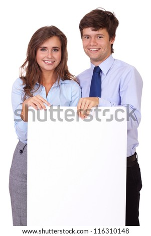 Smiling attractive businesswoman with handsome businessman holding white board, isolated on white