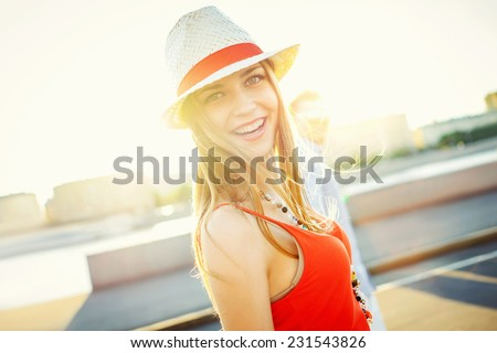 Smiling attractive girl with sunlight - stock photo