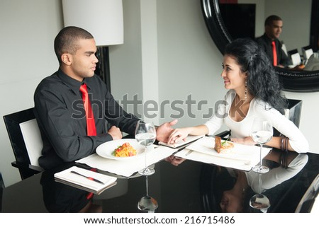 Smiling attractive woman and man having discussion. man holding woman by hand and thinking - stock photo