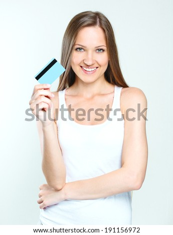 smiling attractive woman holding credit card. blank credit card. - stock photo