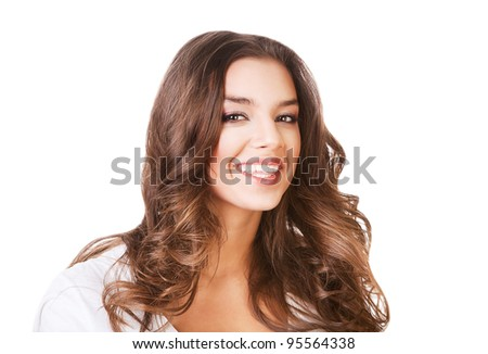 smiling attractive woman in white on white background - stock photo
