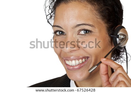 Smiling attractive woman makes with headset a call. Isolated on white background. - stock photo