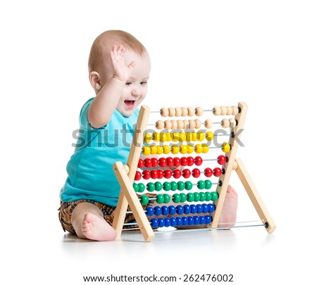 Smiling baby boy playing with counter toy - stock photo