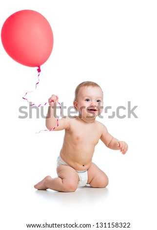 Smiling baby boy  with red  ballon in his hand isolated on white - stock photo