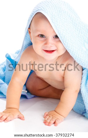 Smiling baby covered with a towel - stock photo