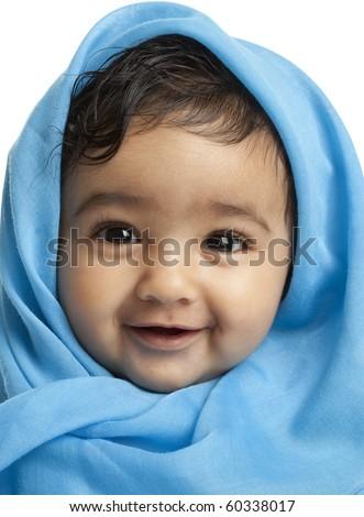 Smiling Baby Girl Draped in Blue Blanket - stock photo
