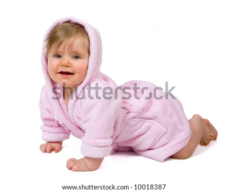 Smiling baby girl in pink bathrobe crawling isolated on white - stock photo