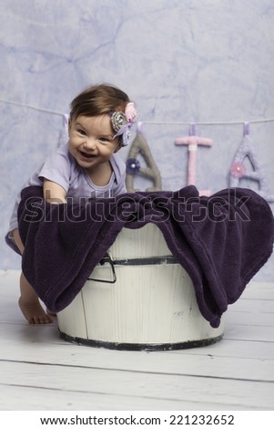 Smiling Baby Girl near tub