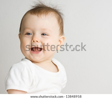 Smiling baby girl with white background. - stock photo