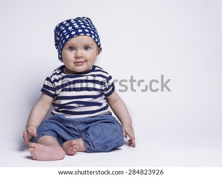 Smiling baby in cute outfit  - stock photo
