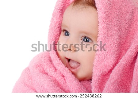 smiling baby in pink towel - stock photo