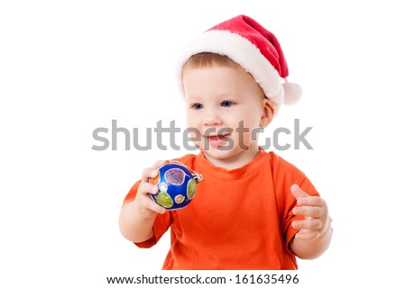 Smiling baby in Santa's hat with Christmas decoration, isolated on white - stock photo