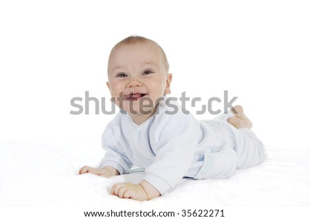 Smiling baby on tummy with white background